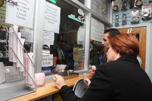 Council Speaker Christine C. Quinn and Council Member Fernando Cabrera talking to store owners about leaflet. (Photo by Maurice Pinzon)
